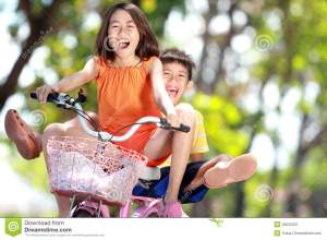 kids-riding-bike-together-26505031